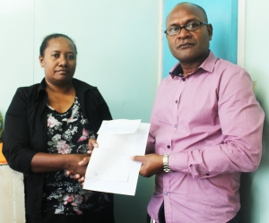 General Manager - Provincial Press Mr. Oscar (left) presenting the Cheque to Mrs. Grace Leziton Finance Manager ACoM