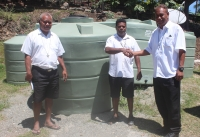 Rev. George Elo (right) handing over the Water tanks to Fr. Philiph Rongotha. Looking on is the Very Rev. Davidson Ngwaeramo