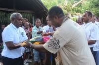 Communities around Merelava presenting a gift wrapped with the Vanuatu flag to Bp Tome during his farewell tour to Merelava district, Torba Province - Vanuatu