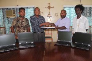 Handing over of laptops